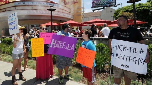 Anti Chick-fil-A protesters hold signs outside a Chick-fil-A fast food restaurant, 1 August 2012 in Hollywood, California