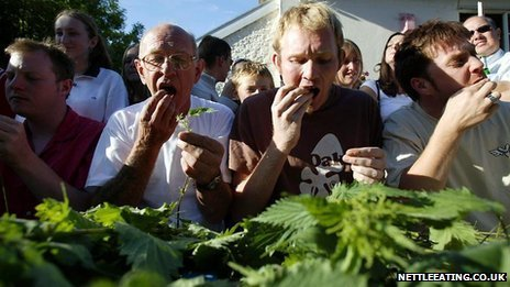Alex Williams (second from left) eating nettles during the competition in 2004