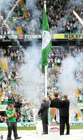 Celtic unfurl the Scottish Premier League championship flag