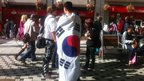 Man wrapped in a South Korean flag