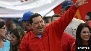 Venezuela&#039;s President Hugo Chavez&#039;s (C) greets supporters during an election rally in the low-income neighbourhood of Antimano in Caracas August 3, 2012.