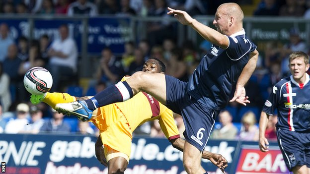 Motherwell's Omar Daley is challenged by Ross Tokely at Victoria Park