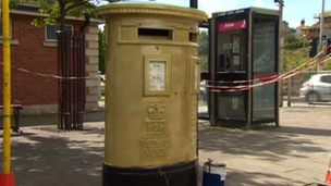 The Wrexham post box being painted gold in honour of rower Tom James' Olympic victory