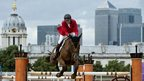 Belgium's Jos Lansink competes in the first individual show jumping qualifier