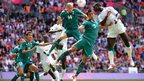 Senegal's forward Moussa Konate challenges Mexico's midfielder Jorge Enriquez and defender Darvin Chavez