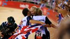 Dani King, Joanna Rowsell, and Laura Trott of Great Britain celebrate winning the gold medal and breaking the world record
