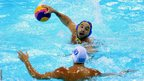 Ioannis Fountoulis of Greece defends against Felipe Perrone Rocha of Spain during men's water polo at Water Polo Arena