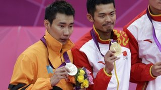 Gold medallist Lin Dan of China (centre) with silver medallist Lee Chong Wei of Malaysia.