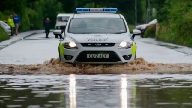 Police car on flooded A477