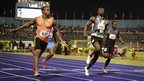 Yohan Blake (left) beats Usain Bolt