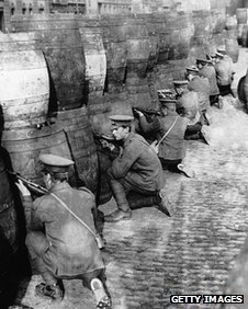 British soldiers take cover behind beer casks during the Easter Rising