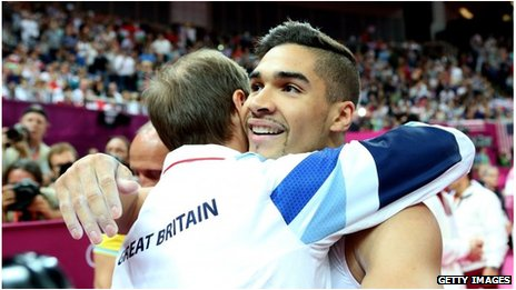 Louis Smith celebrates with coach