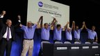 Mars Science Laboratory Curiosity rover flight controllers and managers (L-R) NASA administrator Charles Bolden, JPL director Charles Elachi, NASA associate administrator John Grunsfeld, Richard Cook, Pete Theisinger, Adam Steltzner and John Grotzinger stand as they celebrate after a successful rover landing, at a news conference in Pasadena, California (5 August 2012)