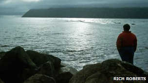 Cox looks across Bering Strait