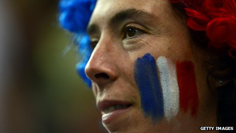 Woman with French flag painted on her face