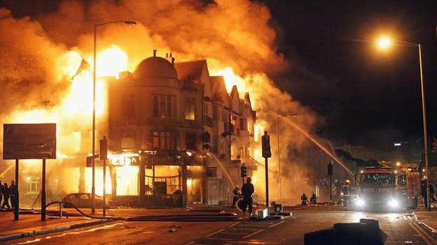 A property on fire during the England riots