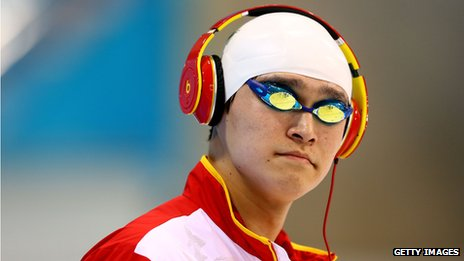 Sun Yang wearing headphones