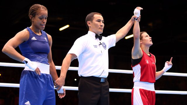 Katie Taylor celebrates defeating Natasha Jonas