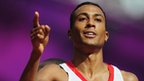 Andrew Osagie of Great Britain reacts after he qualifies for the semi-finals