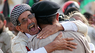 Libyans celebrate the official liberation of the country in October 2011