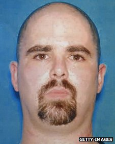 A copy photograph of the mug shot handed out by the FBI of the suspect Wade Michael Page
