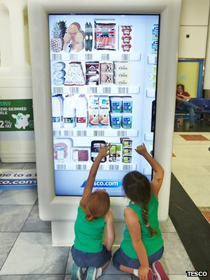 Kids use Tesco shopping machine