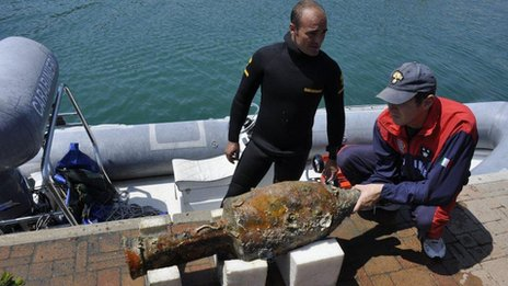 Part of the police diving team with a recovered amphora