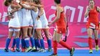 Dutch players celebrate scoring against Great Britain