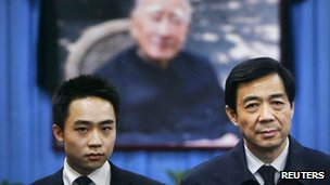 China's former Chongqing Municipality Communist Party Secretary Bo Xilai (R) and his son Bo Guagua stand in front of a picture of his father Bo Yibo in a file photo 18 January, 2007