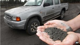 A man holds a handful of volcanic ash that fell on a property in Rangipo near the base of Mt Tongariro, New Zealand after an eruption 7 August, 2012 