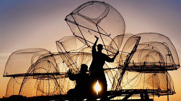 Fishermen prepare their traps in Doha, Qatar