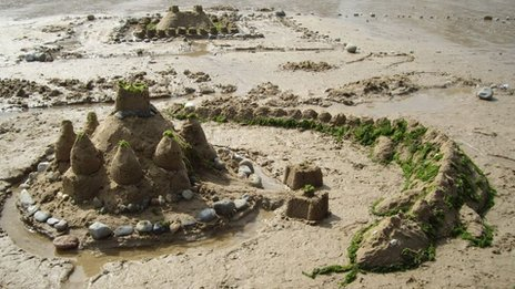 A sand castle guarded by a dragon