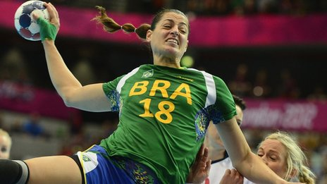 Brazil's left-back Eduarda Amorim jumps to shoot as she vies with a Norwegian player