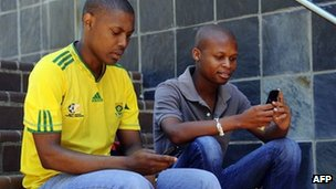 Students use their mobile phones in Johannesburg (archive shot)