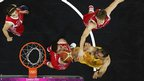Australia's Aleks Maric tries to score past Russia's Sasha Kaun, Andrei Kirilenko and Alexey Shved