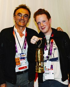 Danny Boyle and Alex Trimble backstage at the Olympic Stadium, with the Olympic flame
