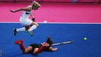 Janne Mueller-Wieland of Germany stretches for the ball as Emily Naylor of New Zealand leaps