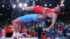 Ryutaro Matsumoto of Japan lifts Rahman Bilici of Turkey