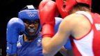 Great Britain's Nicola Adams competes against Bulgaria's Stoyka Petrova