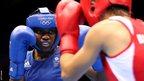 Great Britain's Nicola Adams competes against Bulgaria's Stoyka Petrova