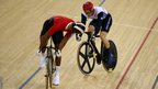 Njisane Nicholas Phillip of Trinidad and Tobago (left) keeps an eye on Jason Kenny of Great Britain