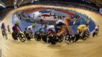 Cyclists compete during the women's omnium 20km points race at the Velodrome