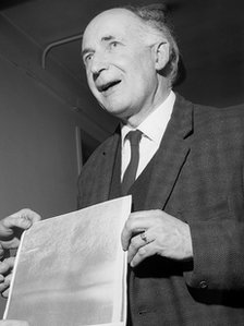 Sir Bernard Lovell holding the first picture of the surface of the moon