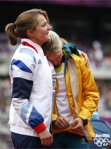 Britain's Goldie Sayers, left, and Australia's Kimberley Mickle embrace during a women's javelin throw qualification round at the London  Olympic Stadium, 7 August