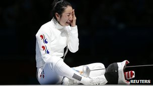 South Korea's Shin Lam cries after being defeated by Germany's Britta Heidemann (not seen) during their women's epee individual semi final fencing competition at the London 2012 Olympics