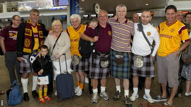 Motherwell fans gather at Glasgow Airport