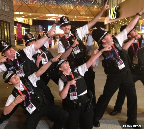 Police officers pose after Usain Bolt's win