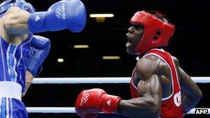 Serge Ambomo boxing against Yakup Sener of Turkey at the London 2012 Olympics