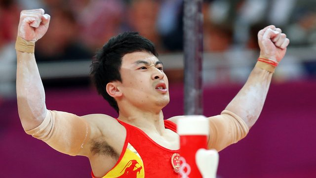 Feng Zhe wins parallel bars gold