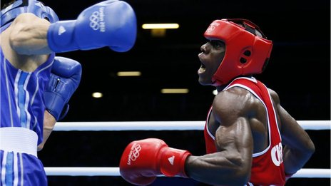 Serge Ambomo boxing against Yakup Sener of Turkey at the London 2012 Olympics